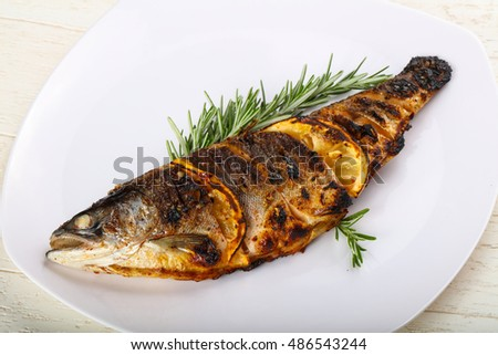 Hot fresh grilled trout with lemon and rosemary