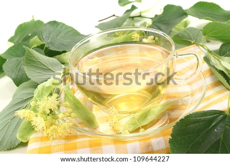 hot fresh lime blossom tea on a bright background