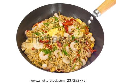 hot frying pan with mushrooms, shrimp and noodles - stock photo