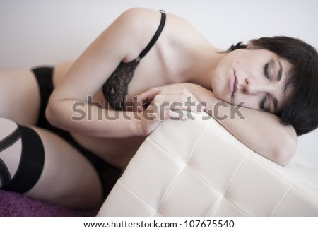 Hot girl dreaming over a pouff lying