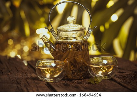 Hot glass of tea on wood table - stock photo
