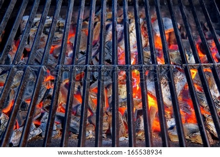Hot Grill and Burning charcoal. You can see more BBQ, grilled food, flames and fire on my page. - stock photo