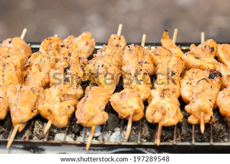 Hot grilling meat on grill - stock photo