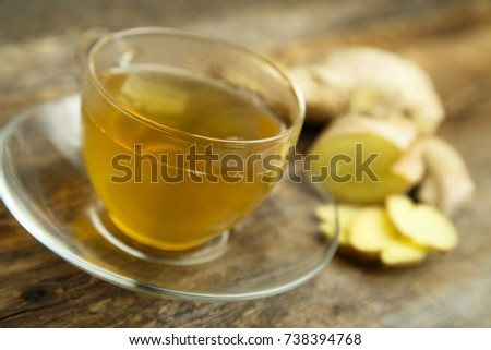 Hot homemade ginger tea with ingredients