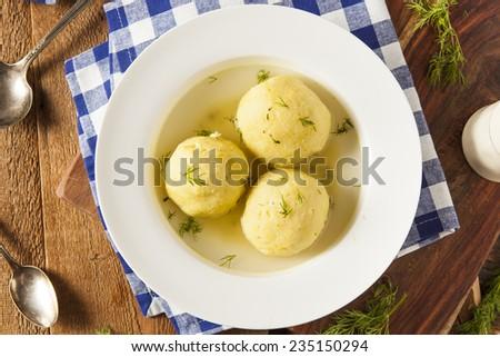 Hot Homemade Matzo Ball Soup in a Bowl - stock photo