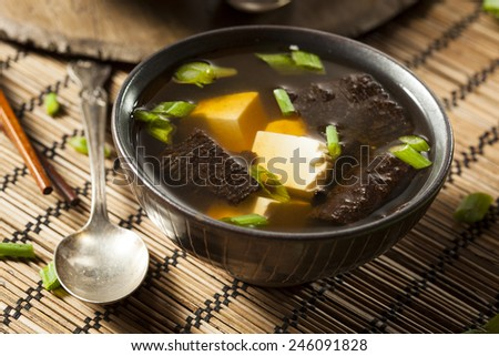 Hot Homemade Miso Soup with Tofu and Seaweed - stock photo