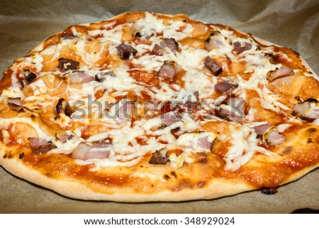 Hot Homemade Pizza with ham Ready to Eat - stock photo