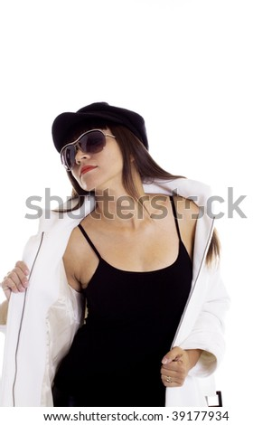 Hot latina model in a white coat, black blouse , beret and sunglasses