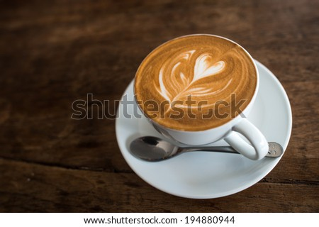Hot latte coffee in cup - stock photo