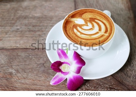 Hot latte coffee in glass - stock photo