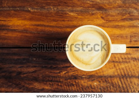Hot latte cup on wooden background - vintage effect style pictures - stock photo