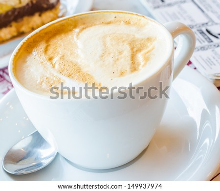 Hot latte in white cup