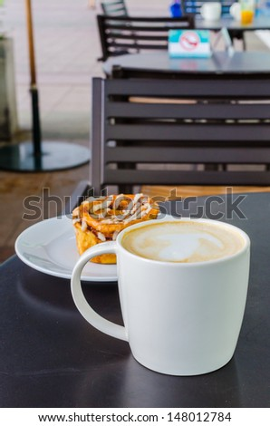 Hot latte on the black table - stock photo