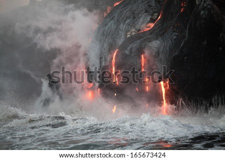 Hot lava stream is flowing into the ocean. Hawaii, Big Island. - stock photo
