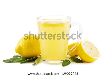 Hot lemon drink with sage leaves on white - stock photo