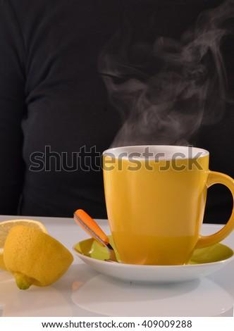 Hot lemonade tea cup and lemon. - stock photo