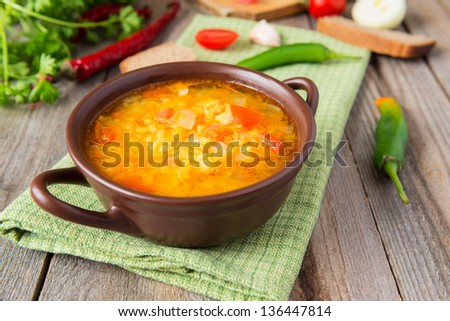 Hot lentil soup with onion - stock photo