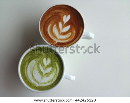 Hot matcha latte and latte art coffee so delicious on white background