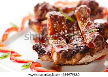 Hot Meat Dishes - BBQ Ribs with Tomatoes and Spicy Sauce - stock photo