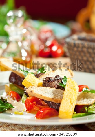 Hot Meat Dishes - Beef Medallions with French Fries, Vegetables and Sauce - stock photo