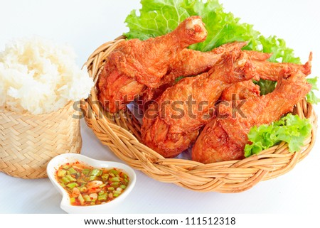 Hot Meat Dishes - Fried Chicken with Red Spicy Sauce and Sticky rice - stock photo