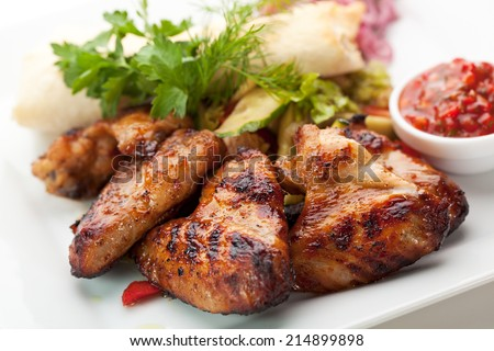 Hot Meat Dishes - Grilled Chicken Wings with Red Spicy Sauce