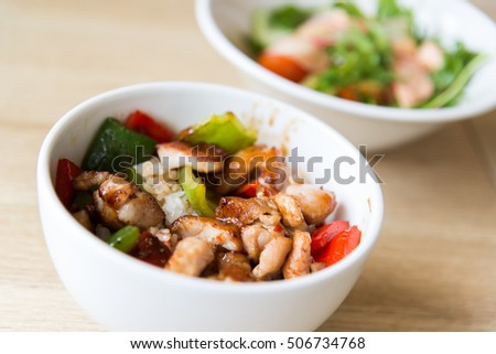 Hot meat salad in a white plate