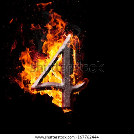 Hot metal burning numbers on black background - number four - stock photo