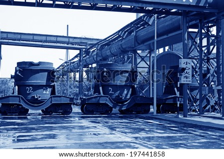 hot metal transport vehicles in a factory, closeup of photo