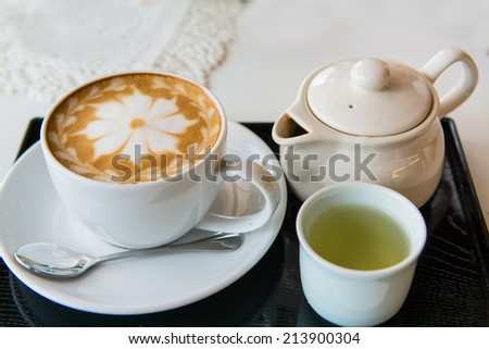 hot milk art coffee and tea , shallow DOF - stock photo