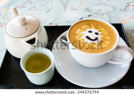 hot milk art coffee and tea , shallow DOF - stock photo