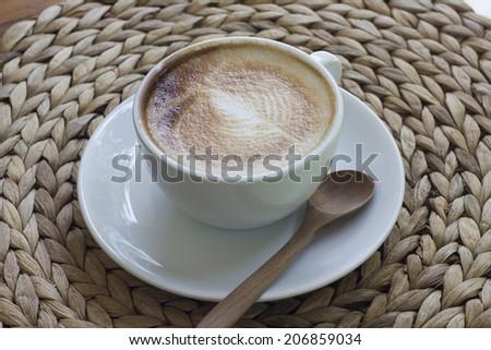 Hot milk art coffee on wooden table. - stock photo