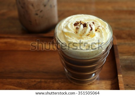 Hot Mocha coffee with whipped cream - on wood salver - stock photo