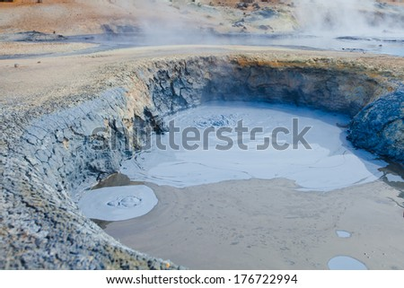 Hot Mud Pots and blue lake in the Geothermal Area Hverir, Iceland. - stock photo