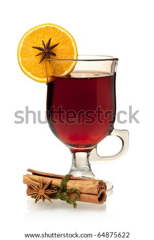 Hot mulled wine with orange slice, anise and cinnamon sticks. Isolated on white - stock photo