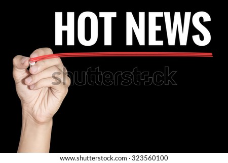 Hot News word writting by men hand holding highlighter pen with line on black background - stock photo