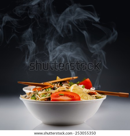 Hot noodles with seafood - stock photo