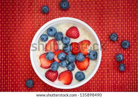 Hot oatmeal breakfast with fresh fruits - stock photo