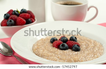 Hot Oatmeal Cereal with Berries - stock photo