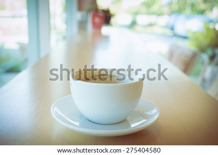 hot of coffee drink on wooden table bar in the cafe - stock photo