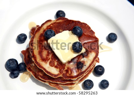 Hot off the grill Blueberry pancakes with fresh blueberries  for breakfast - stock photo
