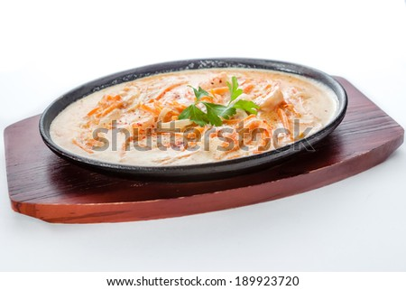 hot pan with shrimp, chicken and vegetables on a white background - stock photo