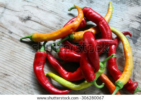 hot pepper - fresh red chili peppers on organic natural wooden rustic background