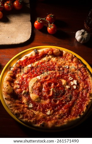 Hot pizza with garlic and marinara sauce - stock photo