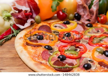 hot pizza with garnish and ingredients - stock photo