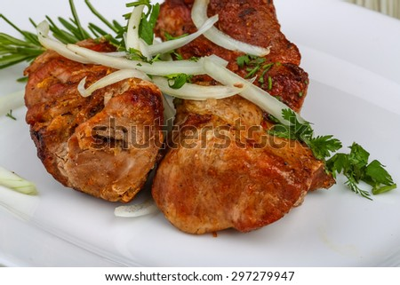 Hot Pork Shashlik with onion rings and spices