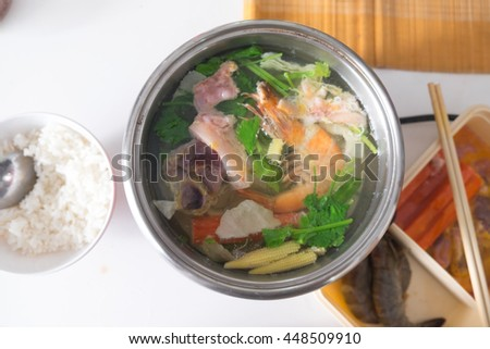 Hot pot soup served with variety of ingredients , homemade