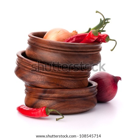 Hot red chili or chilli pepper in wooden bowls stack  isolated on white background cutout - stock photo