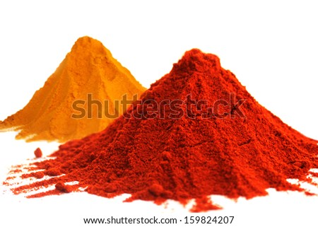 Hot red chili powder and turmeric powder on white background