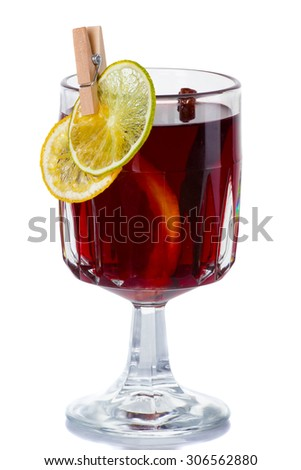 Hot red mulled wine isolated on white background with citrus slices and cinnamon sticks - stock photo
